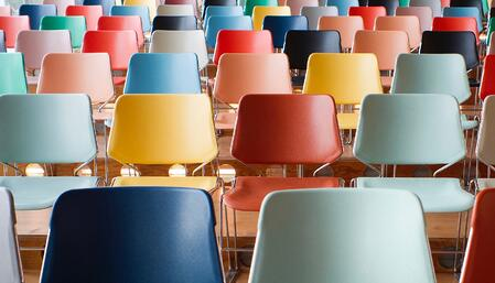 rows of colorful chairs suggesting the scale of performance optimization at an organization